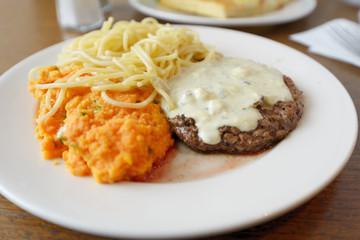 Steak with sauce and garnish