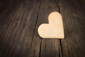 Heart of the cookies and the wooden background.