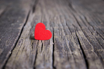 Red heart on wooden background, Valentines Day.