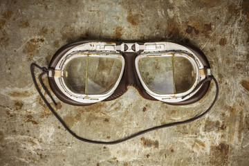 Retro styled image of old leather race goggles