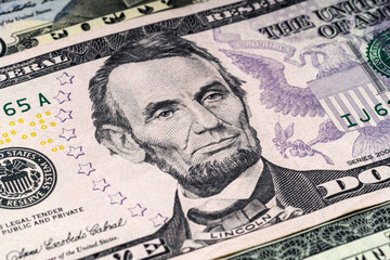 Portrait of Lincoln in front of the dollar bill