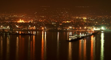 City lights at coastal night