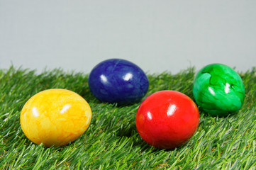 colorful easter eggs on a lawn of artificial green