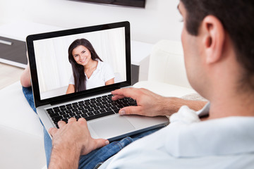 Man Having A Videochat With His Girlfriend