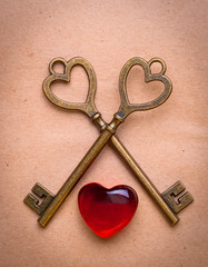 two keys and heart over old paper