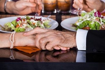Senior Couple Touching Hands