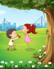 A wedding proposal near the tree