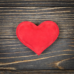 red heart on an old wooden background
