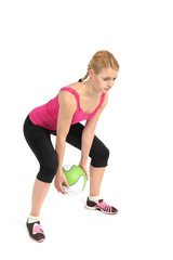 Young lady doing medicine ball workout