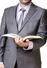 Business man in grey suit holding book