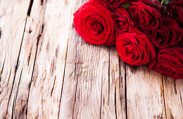 Red roses on wood