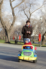 Woman with child riding car