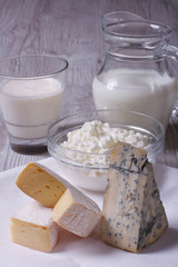 set of products brie, blue cheese, cottage cheese