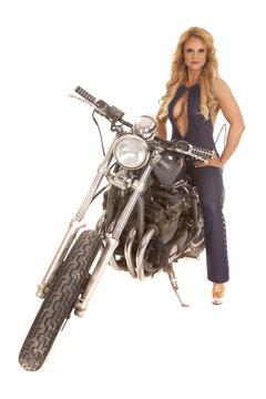 Mature woman denim sit on motorcycle