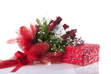 roses and gift on white