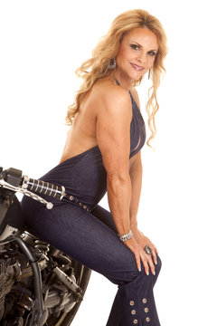 Mature woman sit on motorcycle smiling