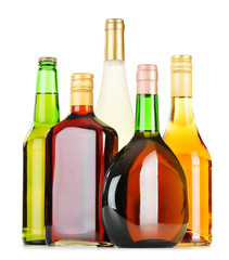 Bottles of assorted alcoholic beverages isolated on white