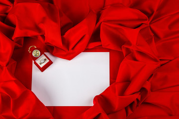 love card with diamond ring on a red fabric