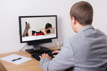 businessman watching porn in computer at work