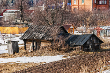 old wooden house in the field