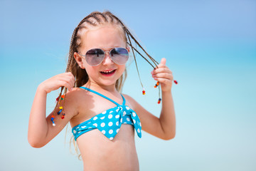 Girl with braids at the beach