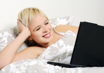 girl with a laptop in bed