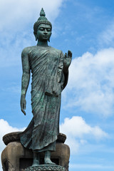 Big Buddha image with blue sky