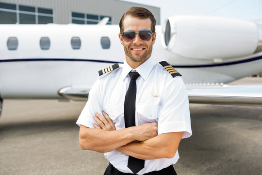 Confident Pilot In Front Of Private Jet