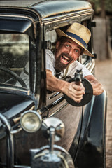 Man in Hat Shooting From Car