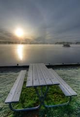 Frosty bench near the lake