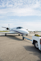 Private Jet Being Towed