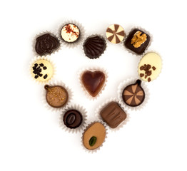 Chocolate pralines in heart shape on a white background
