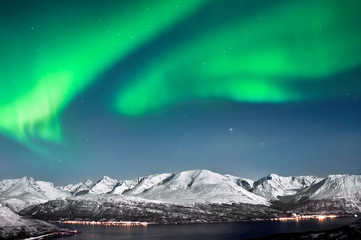 Northern lights above fjords in Norway