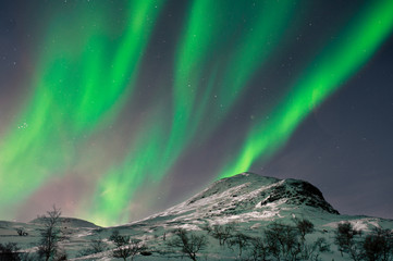 Northern lights above mountain top