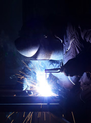 Welder on the industrial workplace.