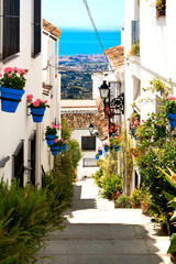 Beautiful street with flowers in the Mijas town, Spain