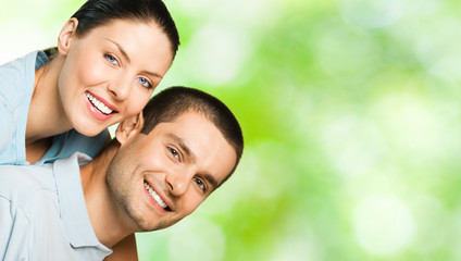 Young happy smiling attractive couple, outdoors
