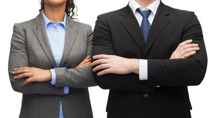 businesswoman and businessman with crossed arms