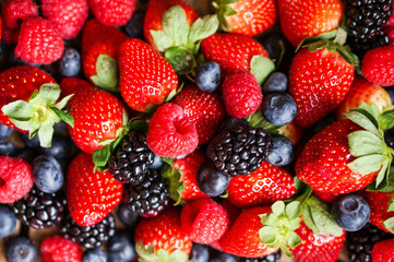 Closeup of fresh berries(raspberries,strawberries,blueberries,bl