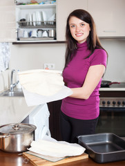 Girl cooking with  shop-bought dough