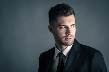 Elegant man portrait against dark background.