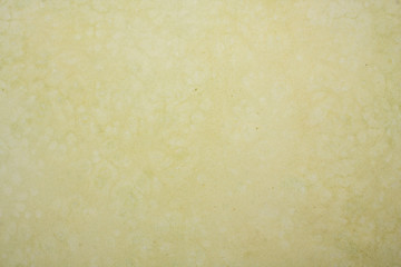 Dirty yellow tinted textured paper
