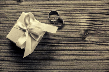 Engagement ring with gift box - wood background
