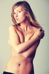 Beautiful blonde woman in gray background