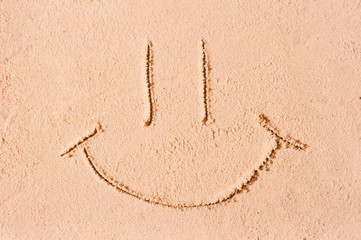 smiley face on the wet sand