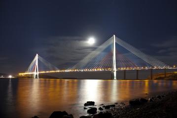 Bridge Russky in Vladivostok at moonlit night. Russia