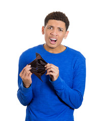Young adult man standing holding empty wallet