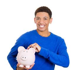 Man holding piggy bank ready to drop a coin save money