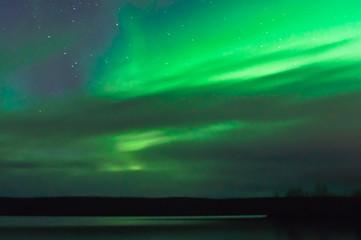 Northern lights behind clouds