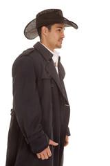 cowboy in coat side view hat